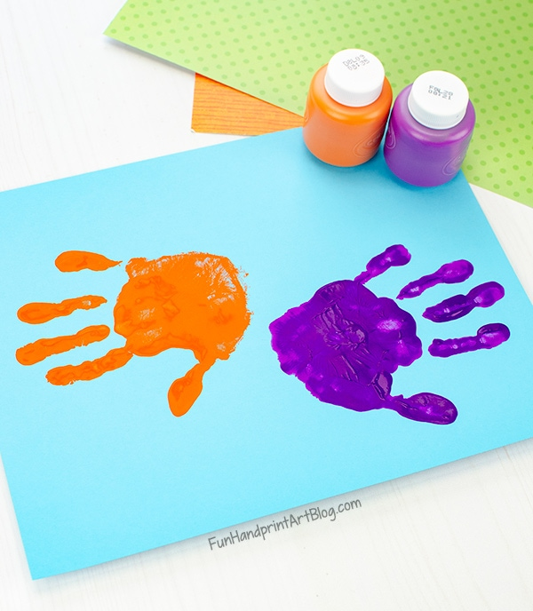 Sideways orange and purple handprints