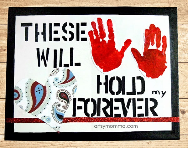 "Keepsake Handprint Canvas Craft with the saying, ""These Hands Will Hold My Heart Forever."""