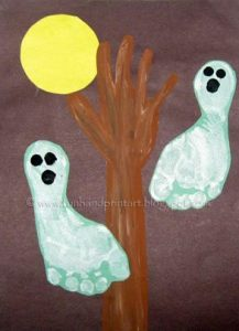 Spooky Halloween Scene with Footprint Ghosts and Hand Shaped Tree