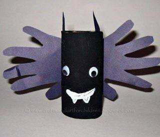 Vampire Bat Handprint Craft made with an empty cardboard tube.
