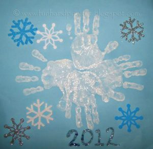 Shimmery Glitter Handprint Snowflake - Winter Craft for Kids