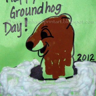 Handprint Groundhog with puffy paint snow