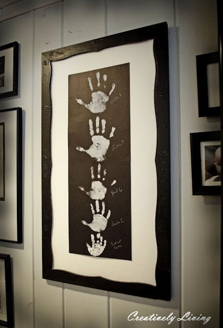 Descending Family Handprints in a Framed Wall Hanging