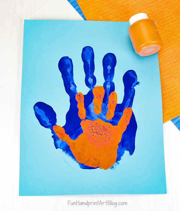 Painted Orange and Blue Handprints