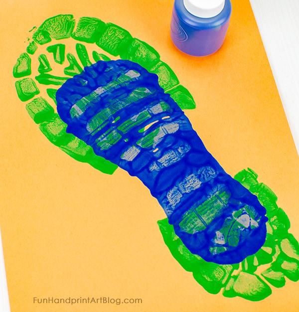Child's Shoe Print inside dad's shoe print