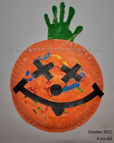 Halloween Craft for Kids: Paper Plate Pumpkin Handprint Craft