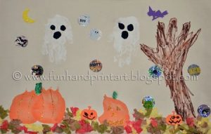 Handprint Halloween Collage Art Scene using paint, markers, glitter glue & stickers