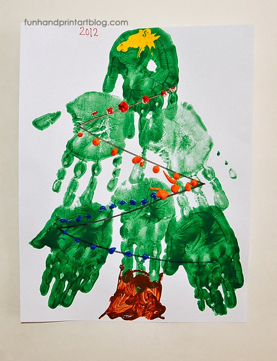 Preschool Christmas Tree Craft Made With Multiple Handprints