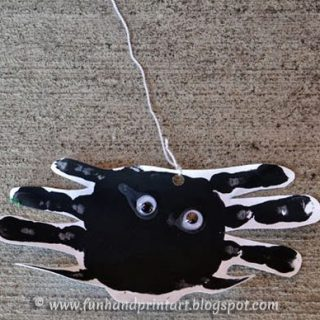 Handprint Spider Hanging from a String