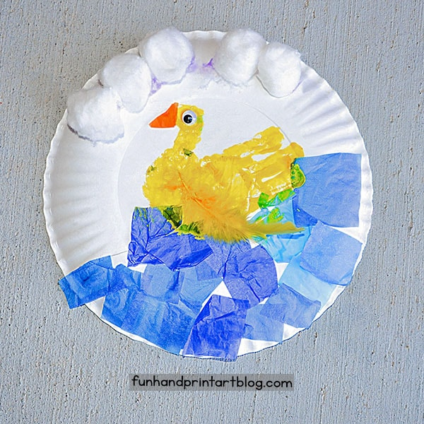 Fun Paper Plate Duck Craft: Made with a handprint and tissue paper
