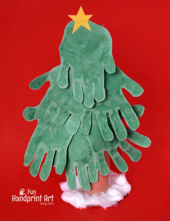 Cardboard Tube Christmas Tree Craft made with Handprints