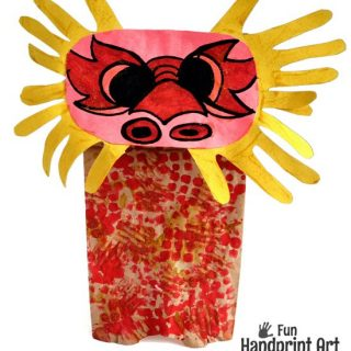Paper Bag Chinese Dragon Puppet made with Handprints