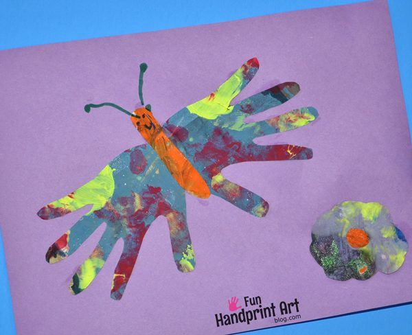 Painted newspaper art for kids fun handprint art for Butterfly hands craft