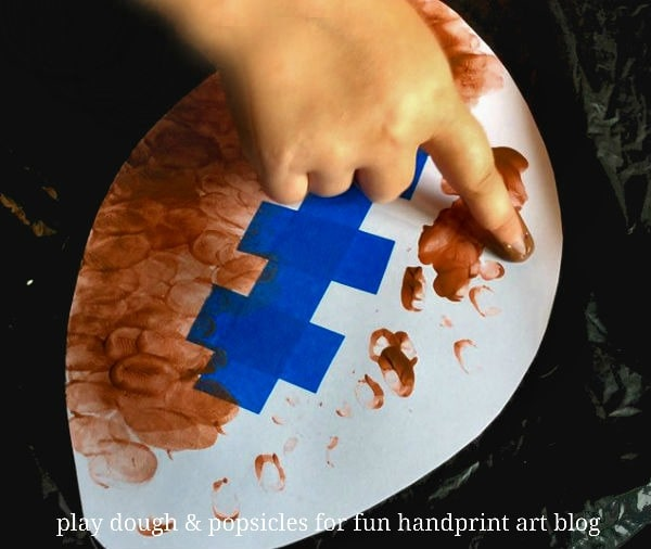 A fun fingerprint football craft for kids using a tape resistant process.