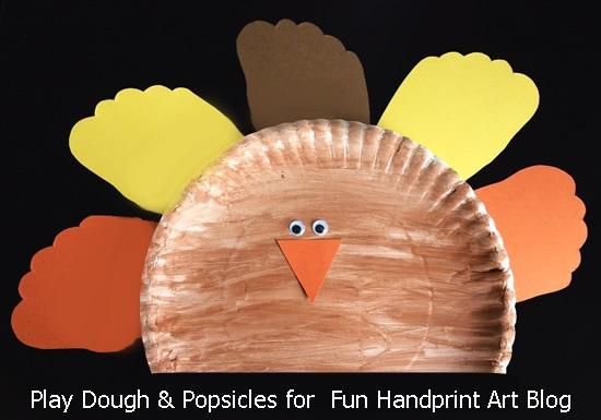 Fun paper plate turkey craft with footprint feathers fun handprint art