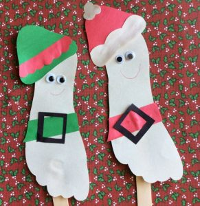 Bring Santa & His Elf To Life With These Stick Puppets Made With Footprints. Perfect Christmas Craft For Home or the Classroom