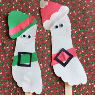 Playful Santa and His Elf Footprint Puppets