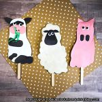 DIY Footprint Farm Animal Puppets On A Stick - Pair with a farm book or use for imaginative play.