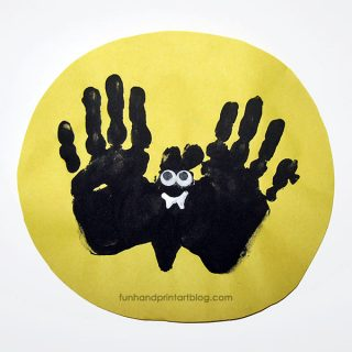Handprint Bat Flying Over the Moon Halloween Craft for Kids
