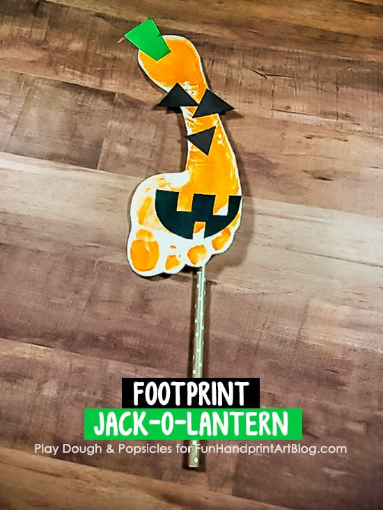 Footprint Jack-o-Lantern Puppet on a Stick Craft for Imaginative Play