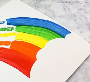 Make a Cloud From White Craft Foam to Glue on the Rainbow Painting