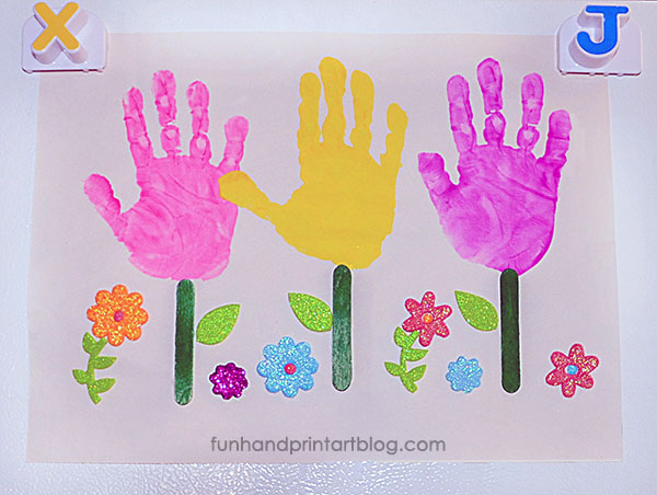 Garden Craft for Kids made using handprints & wood craft sticks