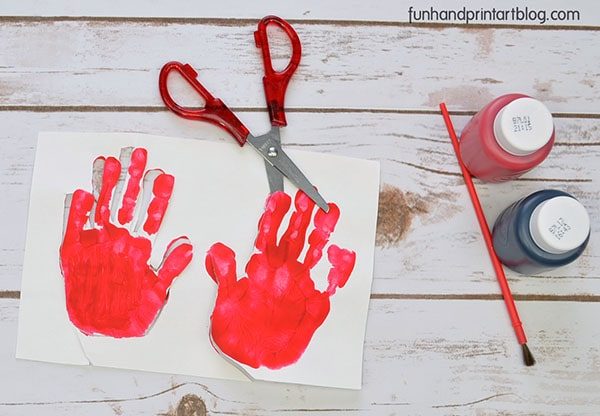 Make wings for the ladybug by cutting the red handprints
