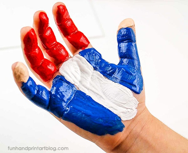Create Uncle Sam by painting the hand with red, white, and blue paint