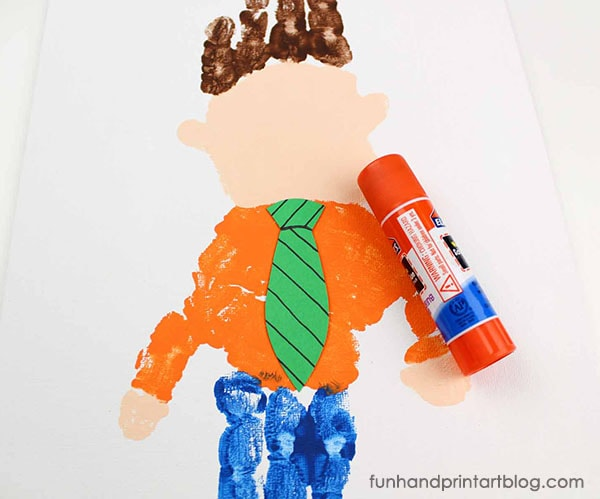 Cute Kids Craft Idea: Make Dad from Handprints - Glue the tie onto the bottom handprint.