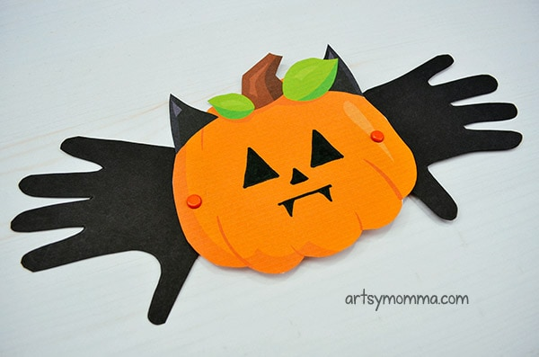 Make a pumpkin bat craft with movable handprint wings!