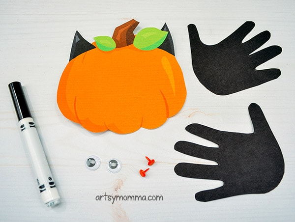 Supplies for creating the handprint bat pumpkin craft
