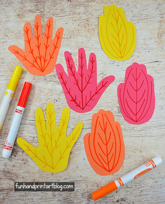 Make paper leaves from traced hand cutouts