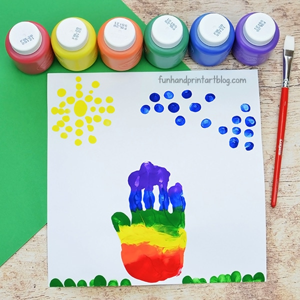 Make a rainbow handprint and fingerprint clouds and sun