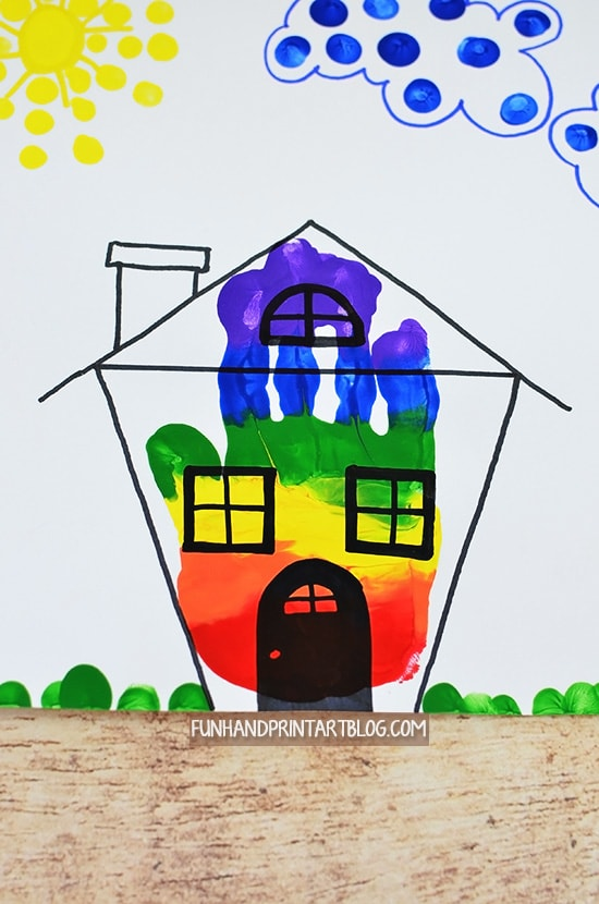Fun rainbow leprechaun trap art project made using a handprint
