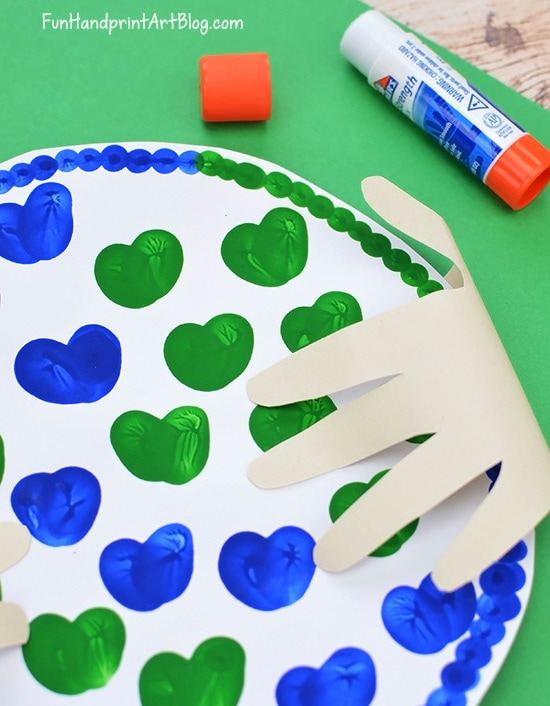 Fold Paper Hand Shapes Over Earth Craft