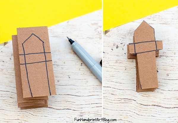 Draw a fence shape on the accordion folded paper and cut out (leaving one end uncut
