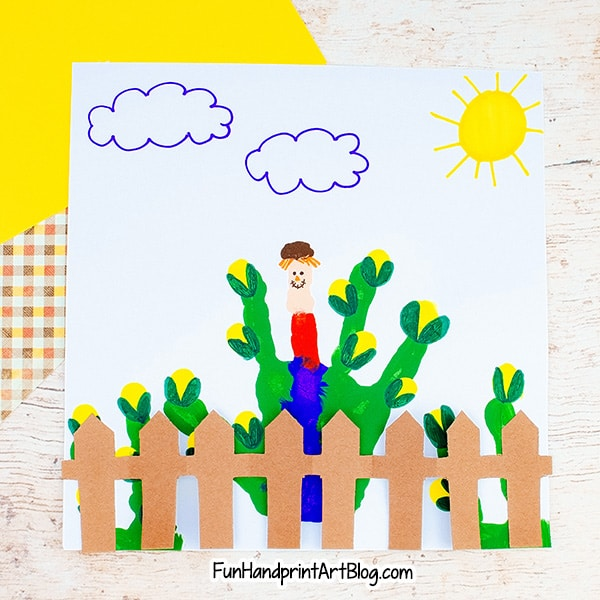Fall Scarecrow Handprint Craft Idea with folded paper fence