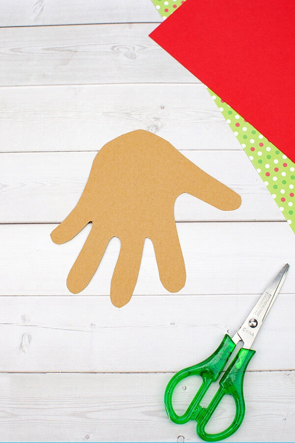 Brown Hand Shaped Paper Cutout