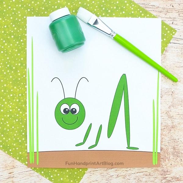 Grasshopper template, green paint, paintbrush